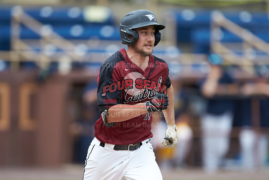 Kokko Figueiredo (18) of the North Carolina Central Eagles hustles down the first base line against the North Carolina A&T Aggies at Durham Athletic Park on April 10, 2021 in Durham, North Carolina. (Brian Westerholt/Four Seam Images)