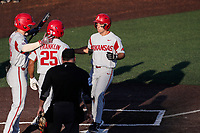 Arkansas Razorbacks second baseman Robert Moore (1) celebrates with Cullen Smith (14) and Christian Franklin (25) following a two-run home run against the Tennessee Volunteers on May 14, 2021, on Robert M. Lindsay Field at Lindsey Nelson Stadium in Knoxville, Tennessee. (Danny Parker/Four Seam Images)