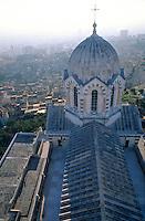 Dome of Notre Dame de la Garde basilica with a view of cityscape, Marseille, France.
