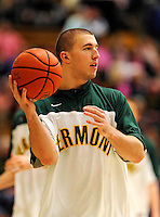 13 February 2011: University of Vermont Catamount forward Brian Voelkel, a Freshman from Pleasantville, NY, warms up prior to facing the Binghamton University Bearcats at Patrick Gymnasium in Burlington, Vermont. The Catamounts came from behind to defeat the Bearcats 60-51 in their America East matchup. The Cats took part in the National Pink Zone Breast Cancer Awareness Program by wearing special white jerseys with pink trim. The jerseys were auctioned off following the game with proceeds going to the Vermont Cancer Center. Mandatory Credit: Ed Wolfstein Photo