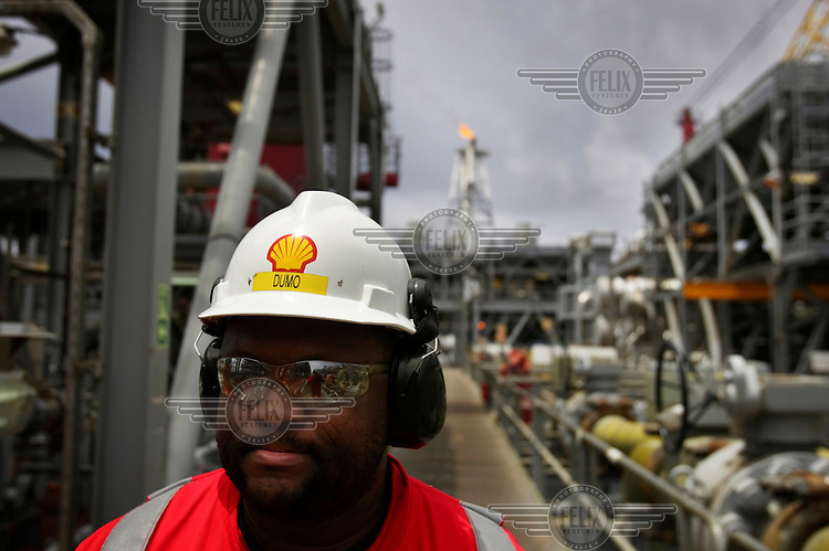 A Shell oil worker on the Bonga oil and gas platform, which is located over 100 km offshore.