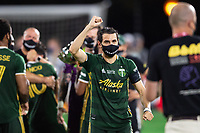 LAKE BUENA VISTA, FL - AUGUST 11: Diego Valeri #8 of the Portland Timbers celebrates a win after a game between Orlando City SC and Portland Timbers at ESPN Wide World of Sports on August 11, 2020 in Lake Buena Vista, Florida.
