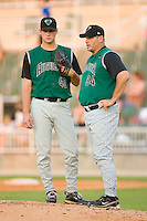 Augusta GreenJackets pitching coach Steve Kline #34 has a chat with Eric Stolp #40 at Fieldcrest Cannon Stadium July 24, 2009 in Kannapolis, North Carolina. (Photo by Brian Westerholt / Four Seam Images)