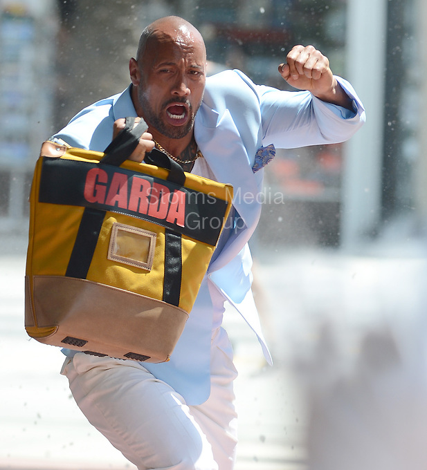 """SMG_FLXX_Dwayne Johnson_Albion_041412_01.JPG<br /> <br /> MIAMI , FL - APRIL 14:  Dwayne Johnson on the set of the new movie Pain and Gain which is directed by Michael Bay . Dwayne Douglas Johnson (born May 2, 1972), also known by his ring name The Rock, is an American actor and professional wrestler who is signed to WWE, appearing on the Raw brand He is often credited as Dwayne """"The Rock"""" Johnson.  on April 14, 2012 in Miami Beach, Florida.  (Photo By Storms Media Group)     <br /> <br /> People:  Dwayne Johnson<br /> <br /> Transmission Ref:  FLXX<br /> <br /> Must call if interested<br /> Michael Storms<br /> Storms Media Group Inc.<br /> 305-632-3400 - Cell<br /> 305-513-5783 - Fax<br /> MikeStorm@aol.com"""