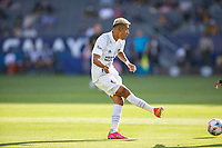 CARSON, CA - MAY 8: Julian Araujo #2 of the Los Angeles Galaxy passess off the ball during a game between Los Angeles FC and Los Angeles Galaxy at Dignity Health Sports Park on May 8, 2021 in Carson, California.
