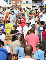 Patrons roam the Saturday morning Farmers Market in downtown Charlottesville, VA