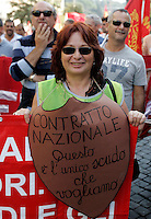"Manifestazione di metalmeccanici a Roma, 9 ottobre 2009, in occasione dello sciopero della categoria indetto dalla Fiom Cgil..Metalworkers demonstrate in Rome, 9 october 2009, in occasion of a strike summoned by Fiom Cgil union. The sign reads ""National contract. This is the only shield that we want""..UPDATE IMAGES PRESS/Riccardo De Luca"