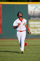 Greeneville Reds left fielder Reniel Ozuna (27) tracks a fly ball during a game against the Pulaski Yankees on July 27, 2018 at Pioneer Park in Tusculum, Tennessee.  Greeneville defeated Pulaski 3-2.  (Mike Janes/Four Seam Images)