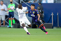 CARSON, CA - JUNE 19: Both Raúl Ruidíaz #9 of the Seattle Sounders FC and Sega Coulibaly #4 of the Los Angeles Galaxy battle for a ball during a game between Seattle Sounders FC and Los Angeles Galaxy at Dignity Health Sports Park on June 19, 2021 in Carson, California.