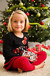 Portrait of girl (6-7) holding Christmas present