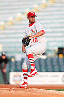 April 29, 2010 Pitcher Arquimedes Nieto of the Palm Beach Cardinals, Florida State League Class-A affiliate of the St.Louis Cardinals,delivers a pitch during a game at McKenhnie Field in Bradenton Fl. Photo by: Mark LoMoglio/Four Seam Images