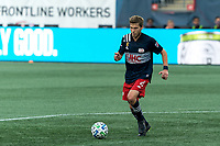 FOXBOROUGH, MA - SEPTEMBER 23: Scott Caldwell #6 of New England Revolution brings the ball forward during a game between Montreal Impact and New England Revolution at Gillette Stadium on September 23, 2020 in Foxborough, Massachusetts.