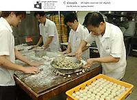 Chefs prepare dim sum dumplings at Victoria seafood in Hong Kong.