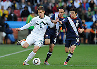 Valter Birsa of Slovenia is surrounded by Landon Donovan and Francisco Torres of USA