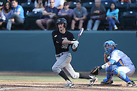 Zack Zehner #42 of the Cal Poly Mustangs bats in front of Shane Zeile #9 of the UCLA Bruins at Jackie Robinson Stadium on February 22, 2014 in Los Angeles, California. Cal Poly defeated UCLA, 8-0. (Larry Goren/Four Seam Images)