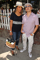 LOS ANGELES - JUL 28:  Arthel Neville, Taku Hirano at the The Ivy on July 28, 2014 in Los Angeles, CA