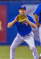 4 April 2015: Toronto Blue Jays first base coach Tim Leiper helps out at first base during batting practice prior to a pre-season exhibition game against the Cincinnati Reds at Olympic Stadium in Montreal, Quebec, Canada. The Blue Jays defeated the Reds 9-1 in the second of two MLB weekend exhibition games. Mandatory Credit: Ed Wolfstein Photo *** RAW (NEF) Image File Available ***
