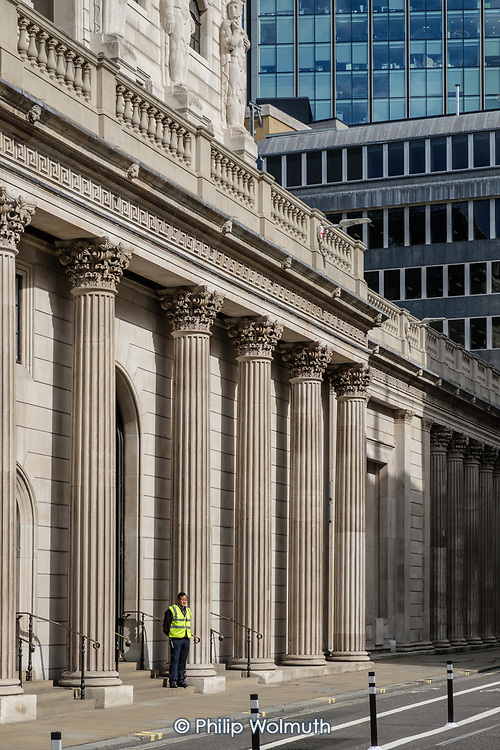 Security Guard, Bank of England, Threadneedle Street, City of London.  Empty streets at lunchtime.