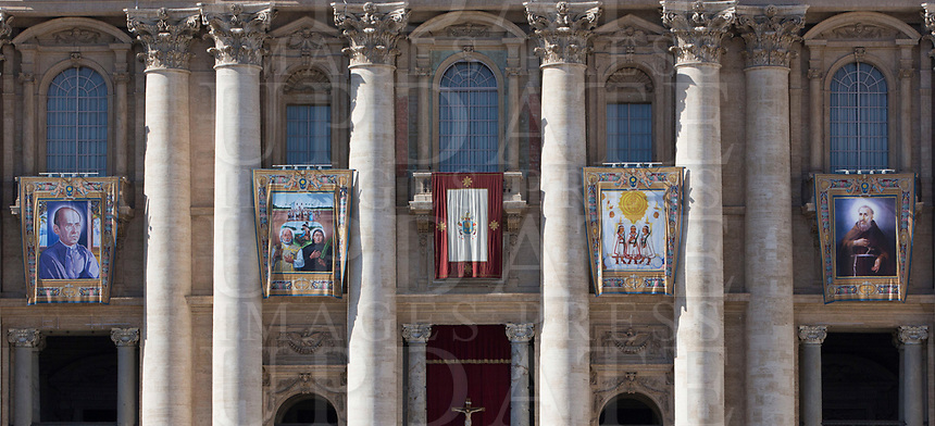 Tapestries of new saints hang from the facade of St. Peter's Basilica at the Vatican, during a canonization mass celebrated by Pope Francis on October 15, 2017.  The pontiff canonized Italian Capuchin priest  Angelo of Acri, Spanish priest Faustino Miguez, the Child Martyrs of Tlaxcala, (Mexico) Cristobal, Antonio and Juan, and the Martyrs of Natal, Jesuit priest Andre de Soveral, diocesan priest Ambrosio Francisco Ferro, layman Mateus Moreira and 27 others, killed in 1645 in an anti-Catholic persecution carried out by Dutch Calvinists in Natal, Brazil. <br /> UPDATE IMAGES PRESS/Riccardo De Luca<br /> <br /> STRICTLY ONLY FOR EDITORIAL USE