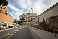"""Via dei Fori Imperiali and Colosseo.<br /> <br /> Rome, 12/03/2020. Documenting Rome under the Italian Government lockdown for the Outbreak of the Coronavirus (SARS-CoV-2 - COVID-19) in Italy. On the evening of the 11 March 2020, the Italian Prime Minister, Giuseppe Conte, signed the March 11th Decree Law """"Step 4 Consolidation of 1 single Protection Zone for the entire national territory"""" (1.). The further urgent measures were taken """"in order to counter and contain the spread of the COVID-19 virus"""" on the same day when the WHO (World Health Organization, OMS in Italian) declared the coronavirus COVID-19 as a pandemic (2.).<br /> ISTAT (Italian Institute of Statistics) estimates that in Italy there are 50,724 homeless people. In Rome, around 20,000 people in fragile condition have asked for support. Moreover, there are 40,000 people who live in a state of housing emergency in Rome's municipality.<br /> March 11th Decree Law (1.): «[…] Retail commercial activities are suspended, with the exception of the food and basic necessities activities […] Newsagents, tobacconists, pharmacies and parapharmacies remain open. In any case, the interpersonal safety distance of one meter must be guaranteed. The activities of catering services (including bars, pubs, restaurants, ice cream shops, patisseries) are suspended […] Banking, financial and insurance services as well as the agricultural, livestock and agri-food processing sector, including the supply chains that supply goods and services, are guaranteed, […] The President of the Region can arrange the programming of the service provided by local public transport companies […]».<br /> Updates: on the 12.03.20 (6:00PM) in Italy there 14.955 positive cases; 1,439 patients have recovered; 1,266 died.<br /> <br /> Footnotes & Links:<br /> Info about COVID-19 in Italy: http://bit.do/fzRVu (ITA) - http://bit.do/fzRV5 (ENG)<br /> 1. March 11th Decree Law http://bit.do/fzREX (ITA) - http://bit.do/fzRFz (ENG)<br /> 2. http://bit.do/fzRK"""
