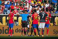 Orlando, Florida - Saturday, June 04, 2016: Patricio Loustau (referee) tries to control the situation during a Group A Copa America Centenario match between Costa Rica and Paraguay at Camping World Stadium.