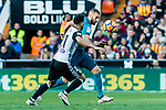 Karim Benzema of Real Madrid (R) fights for the ball with Martin Montoya Torralbo of Valencia CF (L) during the La Liga 2017-18 match between Valencia CF and Real Madrid at Estadio de Mestalla  on 27 January 2018 in Valencia, Spain. Photo by Maria Jose Segovia Carmona / Power Sport Images