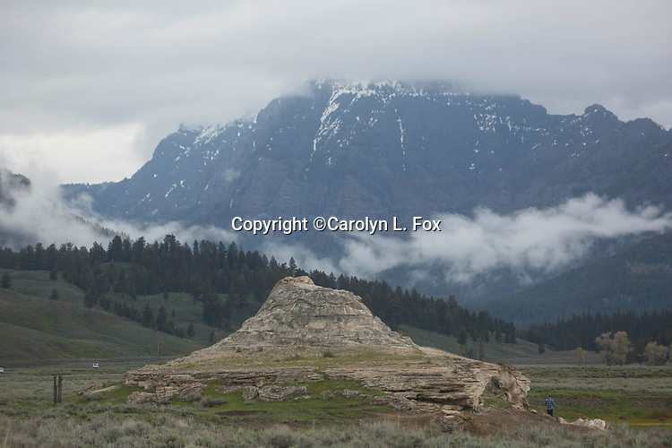 Fog rolls over the mountains surrounding Soda Butte in Yellowstone National Park.