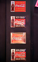 """Pictured: """"Ice Cold Coca Cola Sold Here"""" signs on the wall. Monday 15 May 2017<br /> Re: Coyote Ugly Saloon in Cardiff, Wales, UK."""