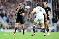 Conrad Smith of New Zealand receives a pass but keeps an eye on Brad Barritt of England during the QBE International match between England and New Zealand at Twickenham Stadium on Saturday 8th November 2014 (Photo by Rob Munro)