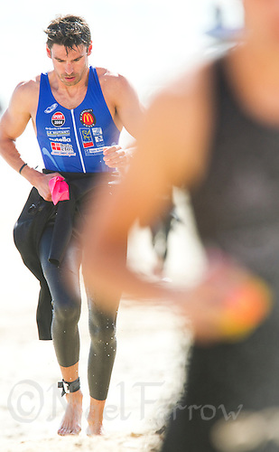 18 SEP 2011 - LA BAULE, FRA - A competitor runs up the beach to transition during the Triathlon Courte Distance (Olympic or standard distance) at the 24th Triathlon Audencia in La Baule, France .(PHOTO (C) NIGEL FARROW)