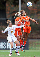 COLLEGE PARK, MD - OCTOBER 28, 2012:  Becky Kaplan (19) of the University of Maryland loses a header to Jordan Roseboro (6) of Miami during an ACC  women's tournament 1st. round match at Ludwig Field in College Park, MD. on October 28. Maryland won 2-1 on a golden goal in extra time.