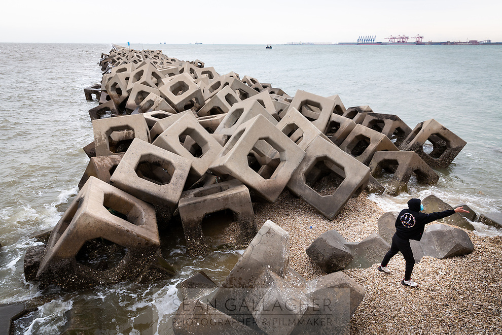 A sea wall protects Dongjiang port in Tianjin. The port has been built largely on reclaimed land and is now one of the busiest port cities in the world. It is protected predominantly by sea walls of various shapes and sizes which help shelter the coastline and the ships delivering goods in and out of northern China. 2019
