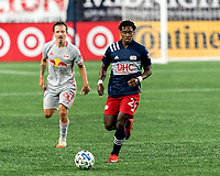 FOXBOROUGH, MA - AUGUST 29: DeJuan Jones #24 of New England Revolution brings the ball forward during a game between New York Red Bulls and New England Revolution at Gillette Stadium on August 29, 2020 in Foxborough, Massachusetts.