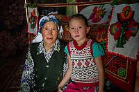 Mongolia, Bayan-Ulgii, Ulgii, Altai Mountains. Woman and children.