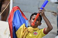 BARRANQUILLA - COLOMBIA - 10-11-2016:  Hinchas de Colombia animan a su equipo durante el partido entre Colombia y Chile por la fecha 11 de la clasificatoria a la Copa Mundial de la FIFA Rusia 2018 jugado en el estadio Metropolitano Roberto Melendez en Barranquilla./ Fans of Colombia cheer for their team during the match between Colombia and Chile for the date 11 of the qualifier to FIFA World Cup Russia 2018 played at Metropolitan stadium Roberto Melendez in Barranquilla. Photo: VizzorImage/ Gabriel Aponte / Staff