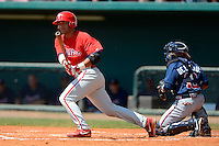 Philadelphia Phillies catcher Gabriel Lino (11) at bat in front of catcher Luis De La Cruz during a minor league Spring Training game against the Atlanta Braves at Al Lang Field on March 14, 2013 in St. Petersburg, Florida.  (Mike Janes/Four Seam Images)