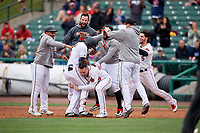 Rochester Red Wings Luis Arraez (9) celebrates a walk off single with Tomas Telis, Brent Rooker (19), Jake Reed, Jordany Valdespin, and Drew Maggi (5) during an International League game against the Charlotte Knights on June 16, 2019 at Frontier Field in Rochester, New York.  Rochester defeated Charlotte 3-2 in the second game of a doubleheader.  (Mike Janes/Four Seam Images)