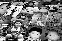 Pictures of young boys that have been stolen from their mothers with messages written on them by their mothers. Thousands of migrant mothers whose children have been stolen and sold to rich families desperate for a boy. Families are limited to a single child under the China's ruthless One Child Policy...PHOTO BY SINOPIX