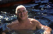Rio de Janeiro, Brazil. Train robber Ronnie Biggs relaxing in the pool at his home in Santa Tereza in 1990.