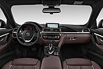 Stock photo of straight dashboard view of a 2018 Alpina B3 S Touring Base 5 Door Wagon