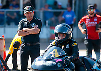 Oct 20, 2019; Ennis, TX, USA; Mike Salinas watches daughter, NHRA pro stock motorcycle rider Jianna Salinas during the Fall Nationals at the Texas Motorplex. Mandatory Credit: Mark J. Rebilas-USA TODAY Sports