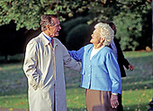 United States President George H.W. Bush hugs first lady Barbara Bush as he departs the South Lawn of the White House in Washington, DC on Friday, October 23, 1992.<br /> Credit: Ron Sachs / CNP