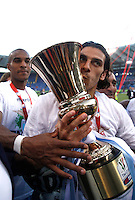 Calcio, finale di Coppa Italia: Roma vs Lazio. Roma, stadio Olimpico, 26 maggio 2013..Lazio forward Sergio Floccari kisses the Italian Cup at the end of the football final match between AS Roma and Lazio at Rome's Olympic stadium, 26 May 2013. Lazio won 1-0..UPDATE IMAGES PRESS/Isabella Bonotto....