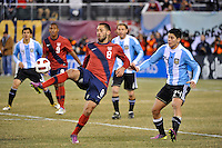 Clint Dempsey (8) of the United States plays the ball under pressure from Marcos Rojo (24) of Argentina. The United States (USA) and Argentina (ARG) played to a 1-1 tie during an international friendly at the New Meadowlands Stadium in East Rutherford, NJ, on March 26, 2011.
