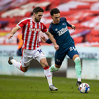 20th March 2021; Bet365 Stadium, Stoke, Staffordshire, England; English Football League Championship Football, Stoke City versus Derby County; Lee Buchanan of Derby County under pressure from Tommy Smith of Stoke City