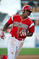 Batavia Muckdogs first baseman David Washington #28 rounds the bases after hitting a home run during a NY-Penn League game against the Williamsport Crosscutters at Dwyer Stadium on August 12, 2012 in Batavia, New York.  Batavia defeated Williamsport 7-2.  (Mike Janes/Four Seam Images)