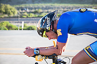 Matt Reed stays hydtrated during the bike portion of the Accenture Ironman California 70.3 in Oceanside, CA on March 29, 2014.