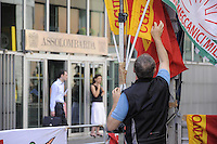 - Milan, demonstration organized by FIOM - CGIL trade union in front of Assolombarda (Industrial Association of Lombardy) in defense of factories in crisis....- Milano, presidio organizzato dal sindacato FIOM - CGIL davanti all'Assolombarda (Associazione degli Industriali Lombardi) in difesa delle fabbriche in crisi