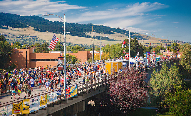 missoula marathons crosses the higgins avenue bridge in downtown missoula montana with spectators lining the course