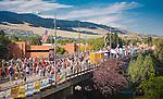 missoula marathons crosses the higgins avenue bridge in downtown missoula montana with spectators lining the course